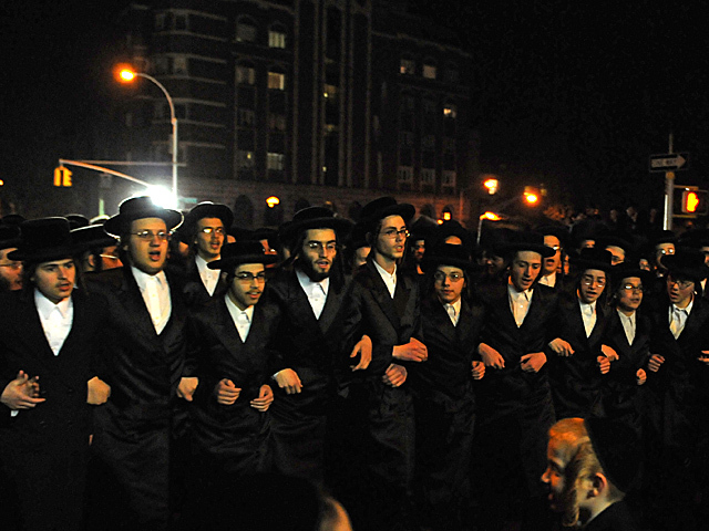 <p>After the wedding thousands of Satmar Hasidic Jews celebrated along Bedford Avenue, Oct. 17, 2012.</p>