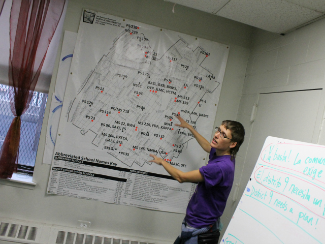 <p>A New Settlement PAC organizer shows a map of District 9. The red dots represent schools the state has identified as struggling.</p>