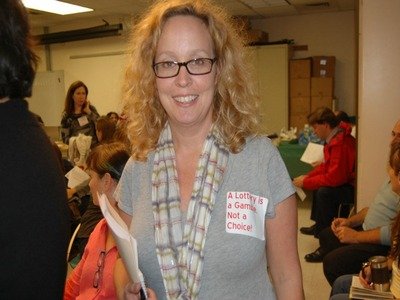 <p>Shannon Treusch Goss, an Uptown parent, wore a sticker opposing the new elementary school choice proposal at a meeting of the District 6 Community Education Council Oct. 18, 2012.</p>