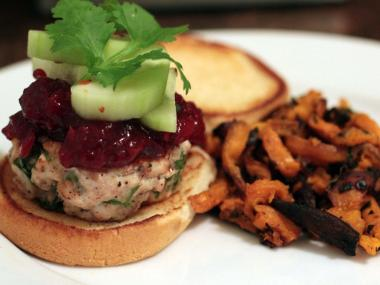 A spiced turkey burger, hoisin cranberry sauce and sweet potato fries put a fresh spin on Thanksgiving.