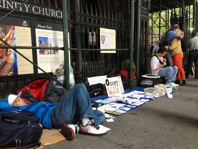 <p>People on the sidewalk outside Trinity Church on Monday, Oct. 15, 2012.</p>