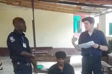 Walter Adler, far right, speaks to a class of potential EMTs in Haiti.
