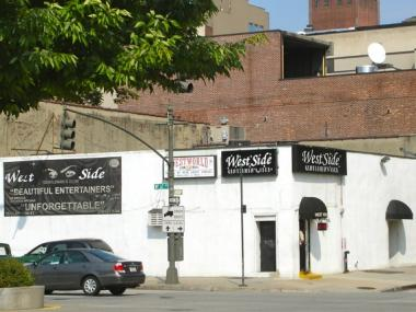 The owner of the adult video store on the West Side Highway at Clarkson Street is seeking community approval for a liquor license at a new strip club.