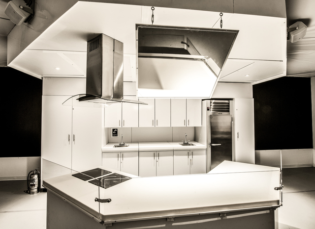 <p>Our Global Kitchen features a 735-square-foot, custom-designed kitchen in the center of the exhibition. The center island holds two convection cooktops and an exhaust hood. The kitchen also features a venting unit, portable sinks and a professional-grade refrigerator. A hanging mirror allows viewers to see demonstrations on the counter surface.</p>