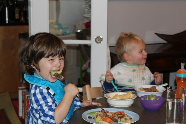 <p>Violet and George enjoy a meal cooked by their moms.&nbsp;</p>