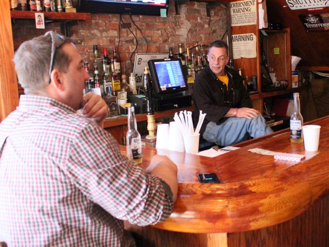 <p>Gary Woloski, manager at the East Village Tavern, chats with a customer. The bar&#39;s draft beer is still not working.</p>