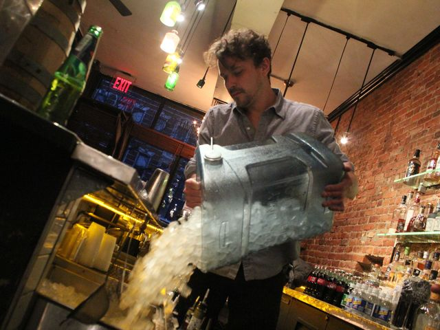 <p>Warren Hode, a bartender at the Summit Bar, gets ice ready for the night because its refrigeration system was knocked out by Hurricane Sandy.</p>