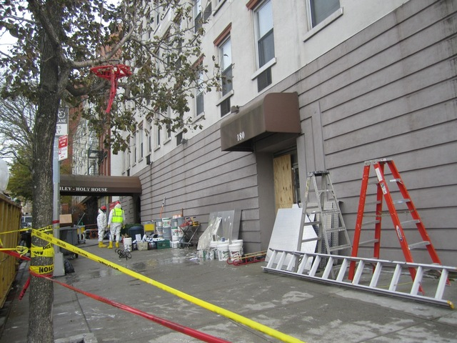 <p>Workers hauled debris out of the Bailey-Holt House Nov. 15, 2012.</p>