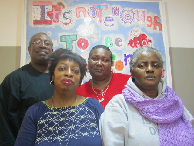 <p>Residence manager Wayman Young, residence coordinator Sheila Hanley (back right), health services coordinator Deborah Moore (front left) and resident Valida Henry said Nov. 15, 2012 they missed their friends at Bailey-Holt House, which closed after Hurricane Sandy because of extensive damage.</p>