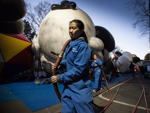 <p>Members of the Macy&#39;s technicians inflate balloons ready for the annual Thanksgiving Day Parade on Nov. 22nd, 2012.</p>