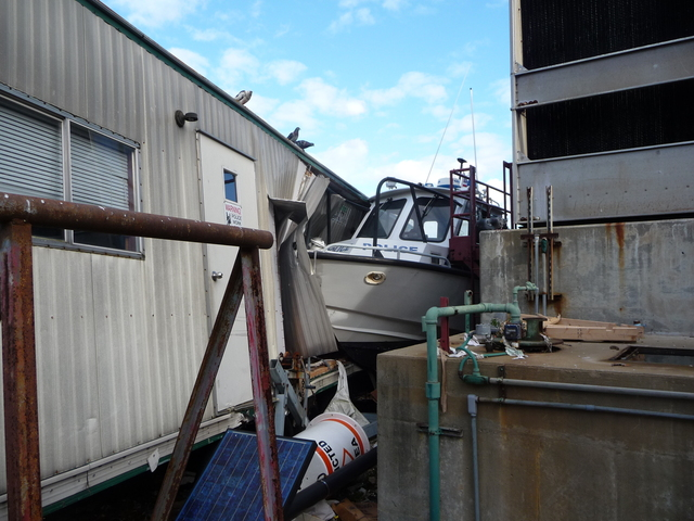 <p>A police boat washed ashore on Ellis Island during Hurricane Sandy, wedging itself between a cooling station and a trailer.</p>