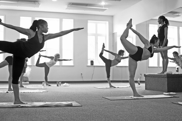 <p>Bikram Yoga-East Harlem co-owner Stephanie Pope Caffey teaches a class at their studio.</p>