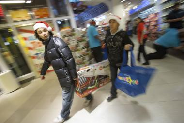 Tens of thousands of shoppers seeking  Black Friday  deals descended on department stores and shopping malls across New York City overnight, the first year that major retailers broke tradition and introduced deep holiday discounts hours before the traditional start of the biggest shopping day of the year.