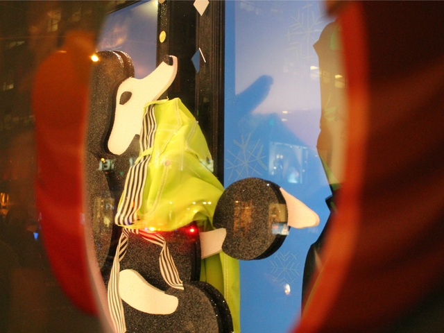 <p>Passersby can peer through holes cut in some window displays, which are also interactive.</p>