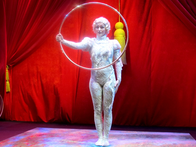 <p>Another performer from Cirque de Soleil put on an act featuring a stack of silver hula hoops.</p>