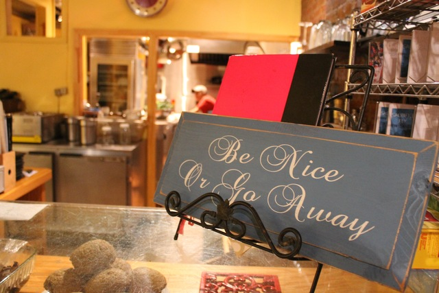 <p>&quot;Be Nice or Go Away&quot; says a sign at Cafe Forant</p>