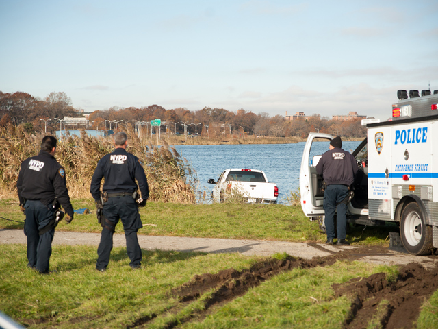 <p>ESU officers prepare to remove the pickup from the water Monday morning, Nov. 19, 2012.</p>