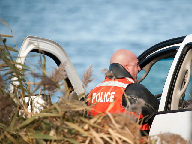 <p>Police look inside the pickup truck Monday morning, Nov. 19, 2012.</p>