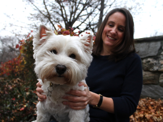 <p>Alison Pace and her dog Carlie.&nbsp;</p>