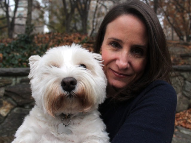 <p>Alison Pace with her dog Carlie.&nbsp;</p>