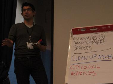 Carlos Menchaca, seen here facilitating a Red Hook community meeting Nov. 14, 2012, has filed to run for City Council.