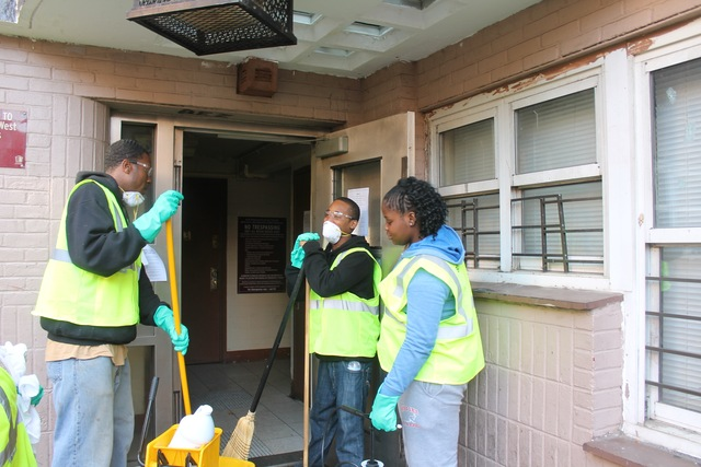 <p>Sanitation workers Mike Lawlry, 25, Tyrone Hollingsworth, 26, and Shante Peterson, 20, stand outside a building at the Red Hook Houses Monday afternoon, Nov. 12, 2012. The smell of garbage from inside wafted through the front door.</p>