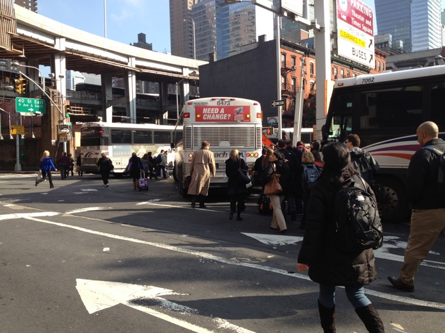 <p>Commuters walked out of the Lincoln Tunnel after a pair of buses crashed inside the tunnel during the early morning rush hour, Nov. 12, 2012.</p>