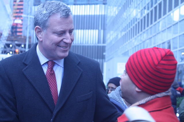 <p>Public Advocate Bill DeBlasio talks to a coprorate&nbsp;dining hall worker during a rally for paid sick days on Nov. 24, 2012.</p>