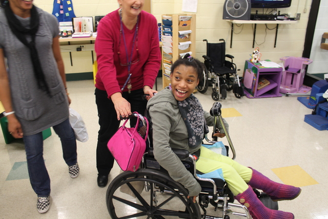 <p>Since her electronic wheelchair was damaged during flooding from Hurricane Sandy, Schevon Williams has had to rely on others to push her around in a manual wheelchair.</p>