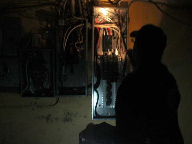 <p>Army veteran Eddie Acosta checks circuit breakers in the basement of VFW Post 5195 in Red Hook. The post sustained serious flooding and damage during Hurricane Sandy.</p>