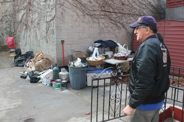 <p>Army veteran Eddie Acosta, 66, surveys the garbage he hauled from VFW Post 5195 in Red Hook, which sustained serious flooding during Hurricane Sandy.</p>