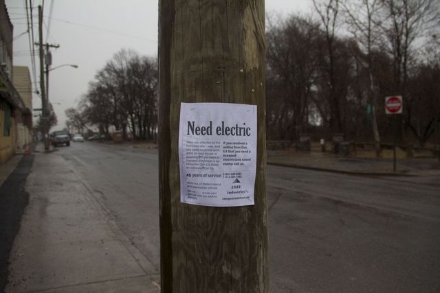 <p>Electricians posted signs all over Cedar Grove Avenue, New Dorp Beach, for residents to get repairs. Before Con Edison will restore power, residents have to get certified by a licensed contractor, but many can&#39;t afford to pay out of pocket and have not received help from their insurance companies and FEMA.</p>