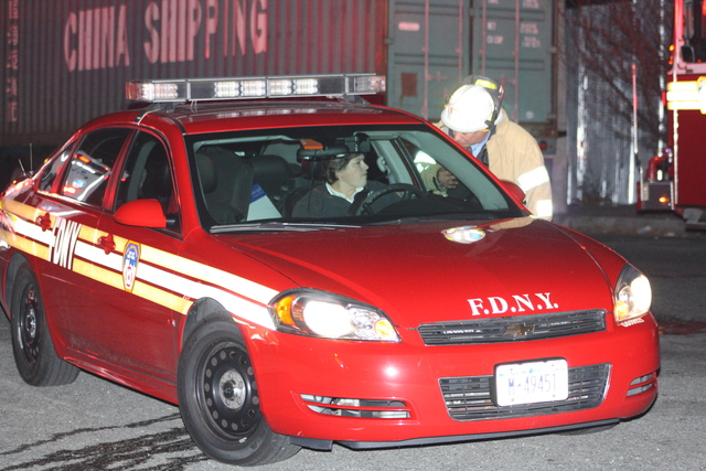 <p>Emergency responders at the scene where a Con Ed worker was burned in an explosion at 55-30 46th St. in Queens Nov. 26, 2012.</p>
