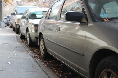 Several cars on W. 22nd St. have not moved since Sandy, leaving the street without cleaning for weeks.