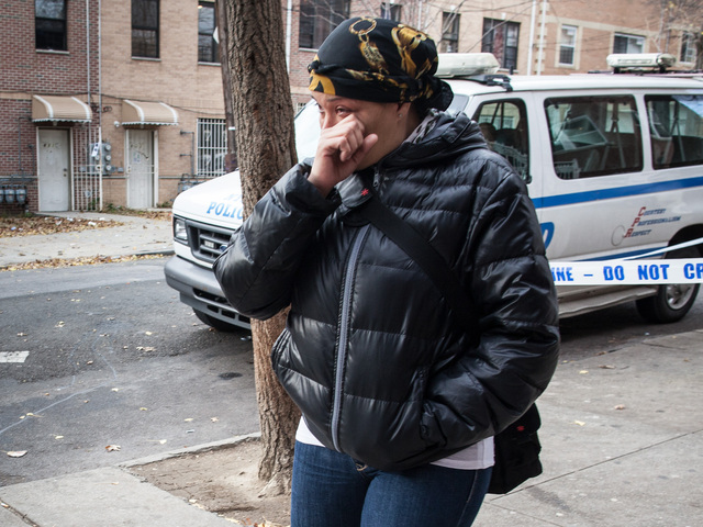 <p>A family member sobs outside the home of Destiny Sanchez, a 15-year-old who was found dead in the Bronx on Nov. 23, 2012.</p>