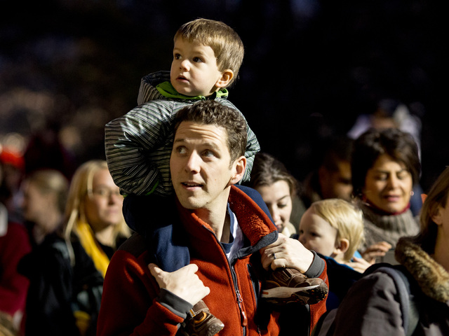 <p>A father and son enjoy the Macy&#39;s Thanksgiving Day balloon blown-up on Nov. 21st, 2012.</p>