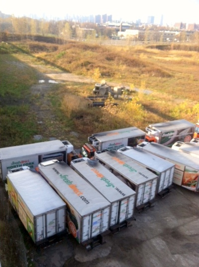 <p>Dozens of FreshDirect delivery trucks damaged by Sandy were stored at the Harlem River Yards in Port Morris on Saturday, Nov. 10, 2012.</p>