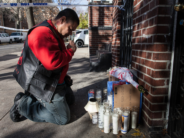 <p>Rafael Sanchez, 45, genuflects at a memorial set up near Destiny Sanchez&#39;s home on Spofford Ave., in the Bronx, one day after the 15-year-old was found dead in a nearby building.</p>