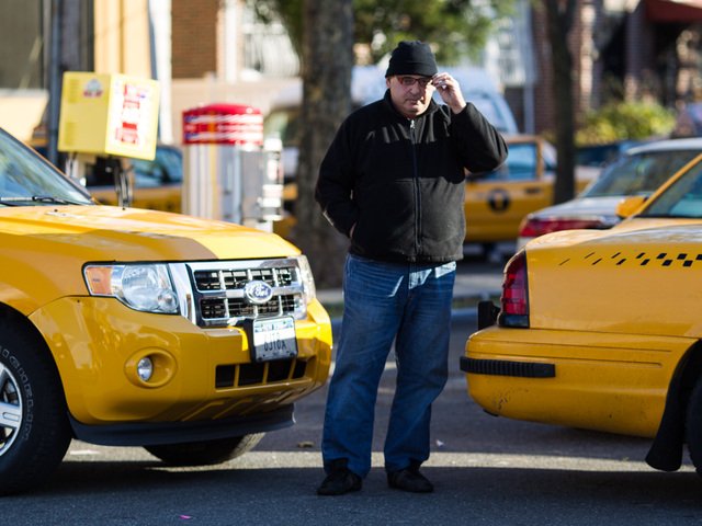 <p>A gas attendant oversees re-fueling for yellow cabs only at the Shell gas station in Jackson Heights, Queens on Nov. 9, 2012.</p>