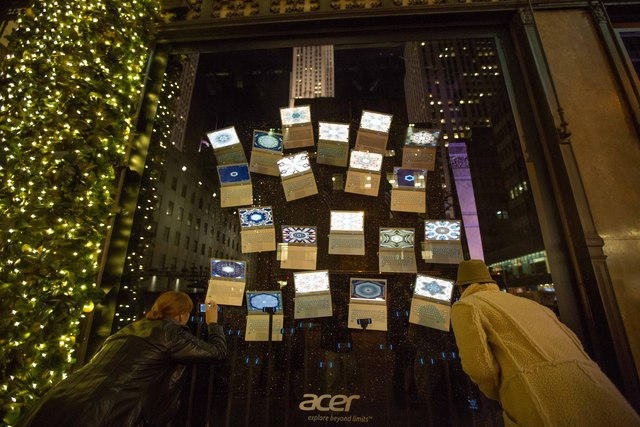 <p>Onlookers tried to take picture of a Saks&#39; windows on Fifth Avenue</p>