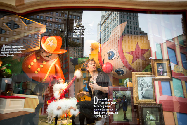 <p>A worker at Macy&#39;s does some fixing to one of its windows on Nov. 19</p>
