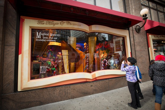 <p>passerby take picture at a windows by Macy&#39;s at Herald Square</p>