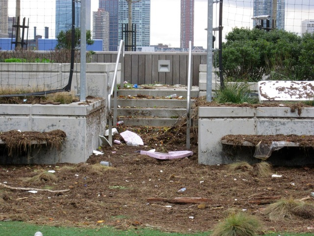 <p>Storm debris littered the turf field on Pier 25 in TriBeca after Hurricane Sandy.&nbsp;</p>