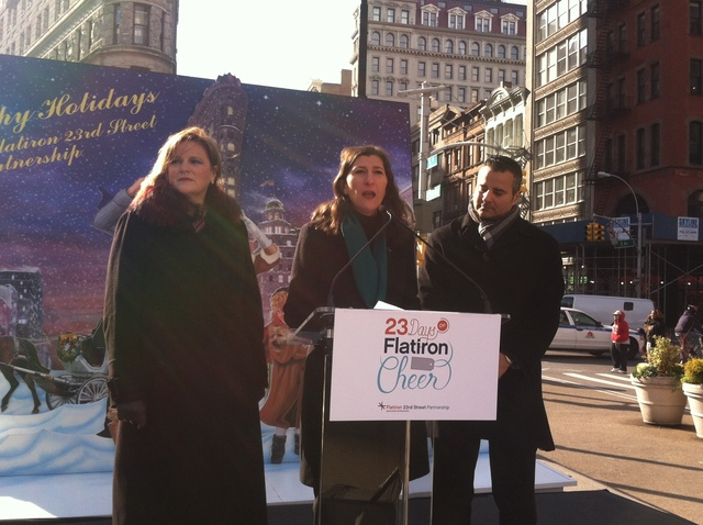 <p>Flatiron/23rd Street Partnership Executive Director Jennifer Brown, at center, talks about some of the holiday events that begin Dec. 1, 2012.</p>