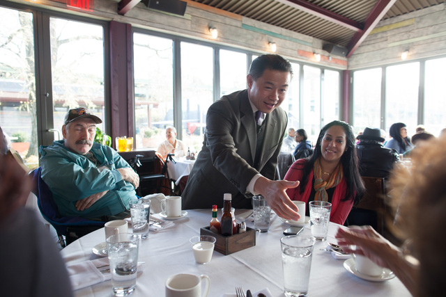 <p>John Chun Liu, 45, New York City comptroller, greets local residents at a Thanksgiving dinner at La Marina restaurant in Northern Manhattan on Nov. 20, 2012.</p>