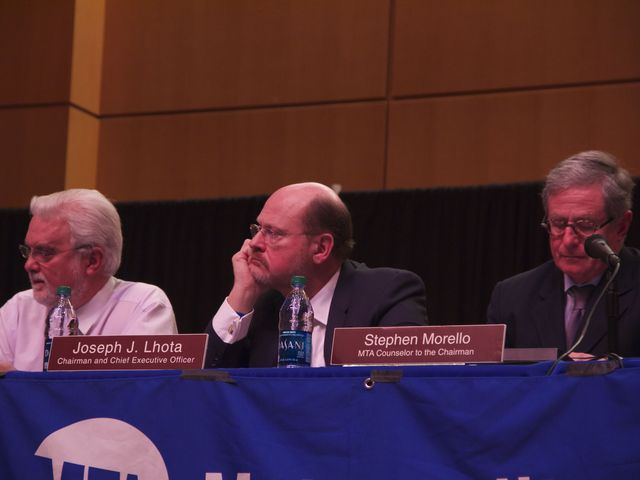 <p>Former MTA chairman Joseph Lhota listens to public statements at a hearing for the fare and toll hike in the College of Staten Island on Nov. 28, 2012.</p>