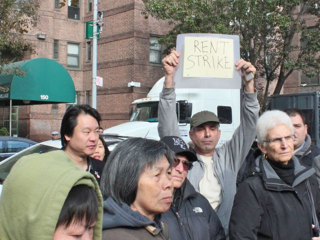 <p>Knickerbocker Village resident Thomas Versella holds up a sign calling for rent strikes after two weeks without electricity, heat and running water.</p>