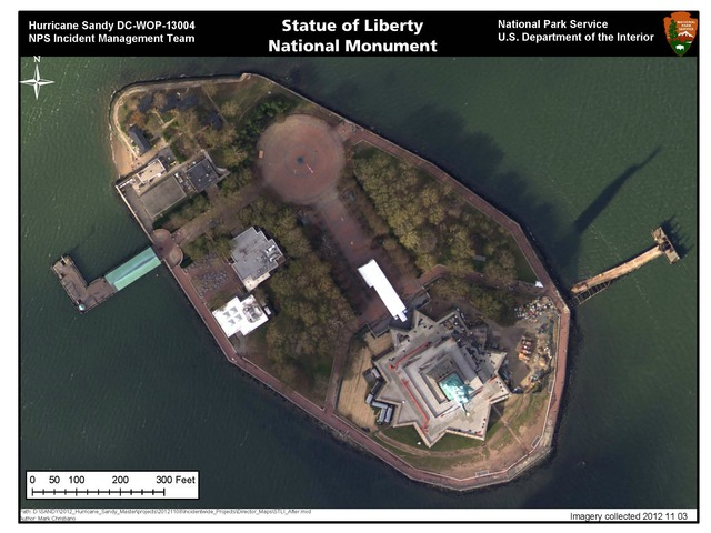 <p>A photo of Liberty Island after Sandy shows damage to the grounds including the dislodged pier in the right corner.</p>