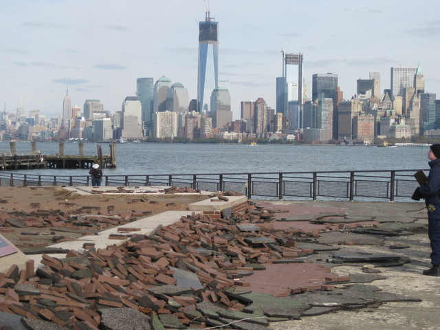<p>Bricks along pathways were uprooted throughout Liberty Island.</p>