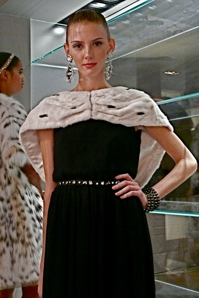 <p>A black and white look with natural ermine cape and Swarovski crystal belt.</p>